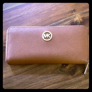 Michael Kors zip closure wallet.